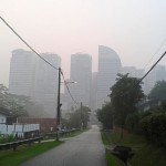 A hazy view of Kuala Lumpur's skyscrapers from Jalan Travers. Although the area is quiet, there is no feeling of danger, just peace.