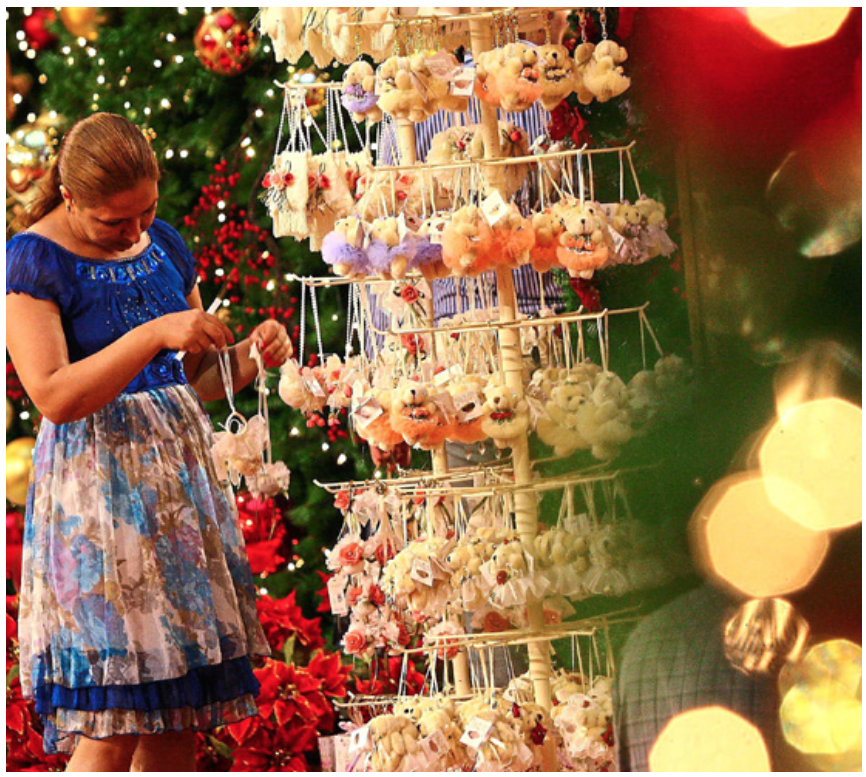 A tourist looking at the little festive gifts offered in Pavilion Kuala Lumpur.