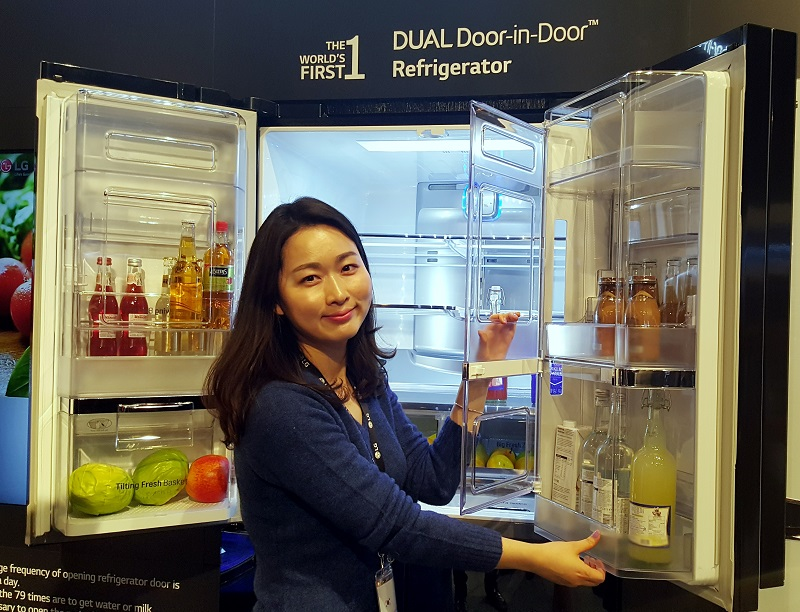 An LG staff showing how the door-in-door feature on refrigerator looks like.