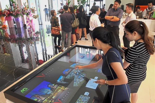 Visitors checking out the exhibits at the opening of the Beacon Concept Gallery and show suites in Jalan Sungai Pinang, George Town.