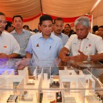 Sime Darby Property managing director Datuk Jauhari Hamidi (right) presenting the details of Sime Darby Property's Harmoni 1 affordable home to Selangor chief minister Datuk Seri (centre) and Selangor exco for Housing, Building Management and Urban Settlement Datuk Iskandar bin Abdul Samad.