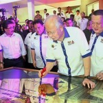 For the people: Najib signing the official opening plaque during the Residensi Pandanmas handing over ceremony as Tan (right) and Federal Territories Minister Datuk Seri Tengku Adnan Tengku Mansor (third from right) look on.