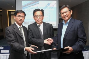 Deal sealed: (from left) Chew, Lasseters International CEO Paul Wong and AccorHotels vice-president, development, and executive director, Indonesia-Malaysia, Rio Kondo exchanging the documents.
