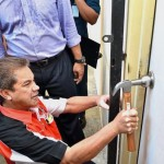 DBKL Housing Enforcement Inspectorate officer Hassan Kassim knocking out the door knob at one of the units at Kerinchi Lembah Pantai PPR to reclaim units with illegal tenants or tenants who have defaulted. — Photos: HAZIM FAUZI/The Star
