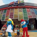 Children posing for a photo with Smurf characters near the entrance of the Movie Animation Park Studios. — SAIFUL BAHRI/The Star