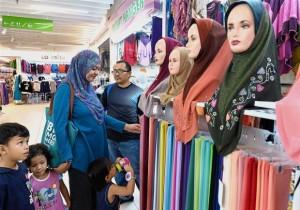 Fariza, her husband Herman and their children looking for their baju raya in KWC.
