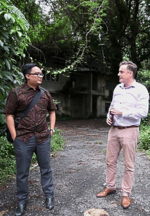 Joseph (right) and architect Syakir Mahadzir discussing about the potential of the neglected site dotted by multiple abandoned bungalows to the rear of Old Malaya in Jalan Raja Chulan. — Photos: SADIQ SANI/The Star