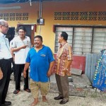 Bentan (in blue) showing the guests his uncompleted house that has been under renovation for over 20 years in Kampung Terang, Balik Pulau.