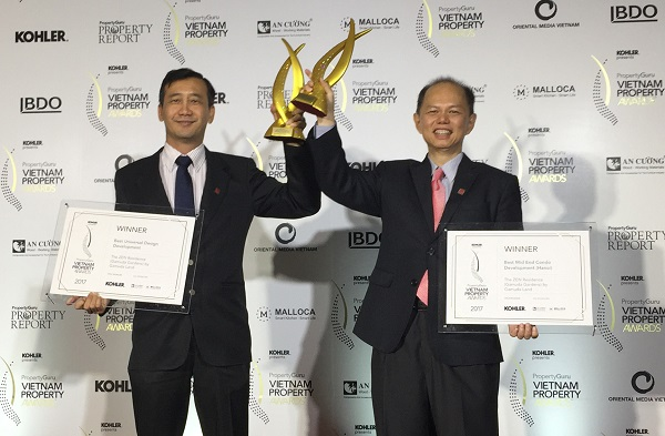 From L-R Gamuda City, Vietnam general director Chow Chee Fan and Gamuda City deputy general director Dennis Ng with the Best Mid End Condo Award and Best Universal Design Development Award at the prestigious Vietnam Property Award 2017.