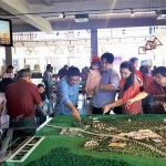 Potential buyers viewing the miniature model of Andira Park.