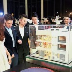 Guests looking at a scale model of the Oasis 3 triple-storey commercial lot units during the launch.