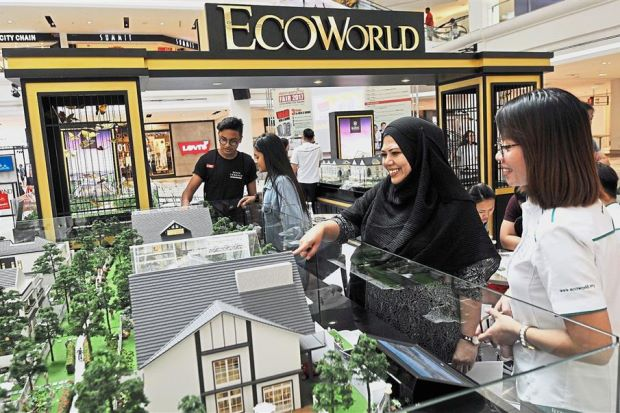 Visitors checking out the EcoWorld Development Group Berhad booth. — Photos: ABDUL RAHMAN EMBONG