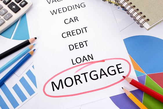 The word Mortgage circled in red with a list of saving and debt obligations surrounded by graphs, charts, books and pencils.
