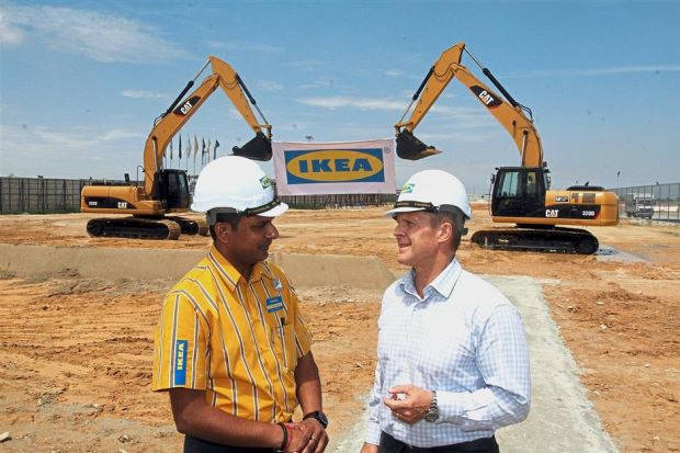 Rojkjaer (right) having a chat with Pathmalingam during the ground-breaking ceremony in Batu Kawan, Penang.