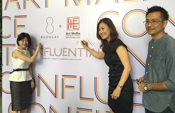An artful tribute to Malaysia.  (From left) KSK Berhad group CEO and KSK Land managing director Joanne Kua, Art WeMe Contemporary Gallery director Liew Su Fei and Malaysian artiste Ng Foo Cheong at the launch of KSK Land's Confluential Art Exhibition. 'Confluential' represents a marriage of confluence, confidence and influential.