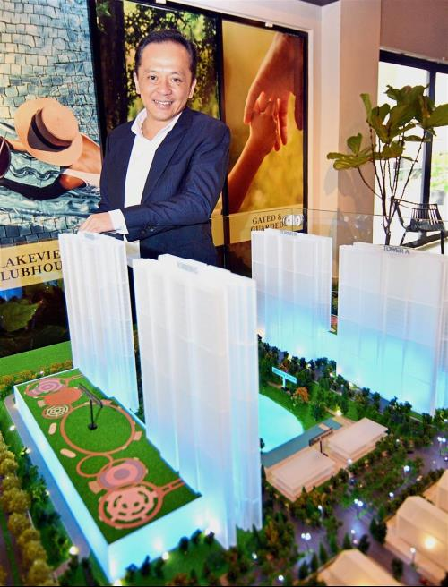 Kong showing a model of Lakefront Condominiums at the Emerald Hills sales gallery in Alam Damai, Cheras.