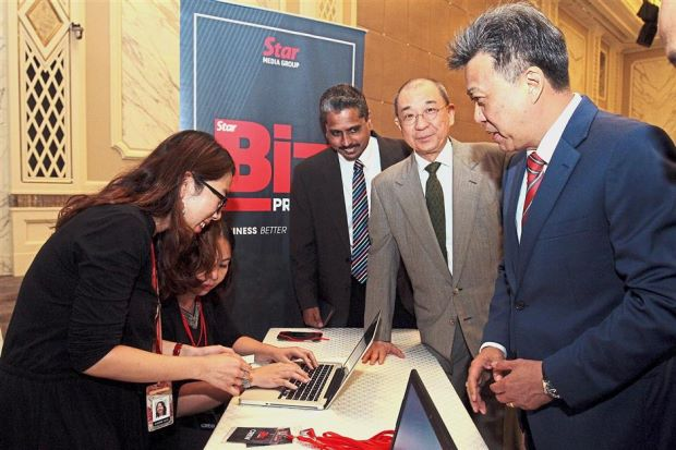 First to sign up: Waterfront Capital Group chairman Tan Sri Chua Ma Yu (second from right) was the first person to sign up for StarBiz Premium during the launch yesterday at St Regis Hotel. With him are Star Media Group CEO/MD Datuk Seri Wong Chun Wai and The Star specialist editor M. Shanmugam.