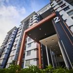 The double-volume ceiling enhances the grand entrance of Seri Kasturi Apartment, Setia Alam.