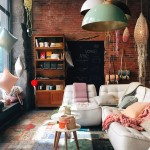 This urban loft epitomises the new rustic-industrial aesthetic - with an exposed clay brick wall and roughly-hewn concrete forms of industrial origin accompanied by reclaimed wood furniture.