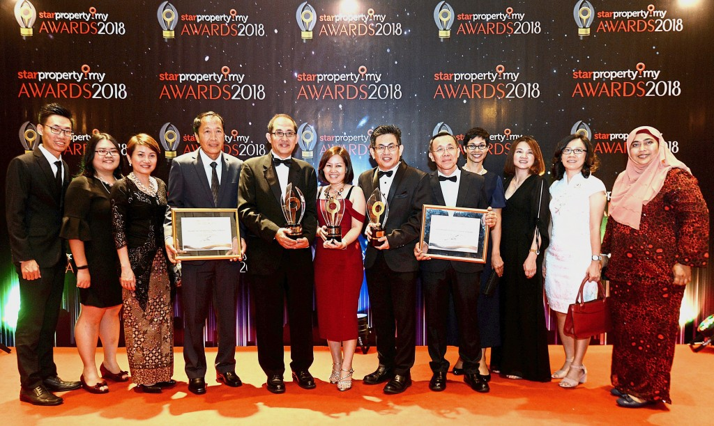 (Fifth from left) Paramount Property CEO Beh Chun Chong, business development manager Ooi Wan Ling and chief operating officer Wang Chong Hwa proudly showcasing their multiple victories with the team