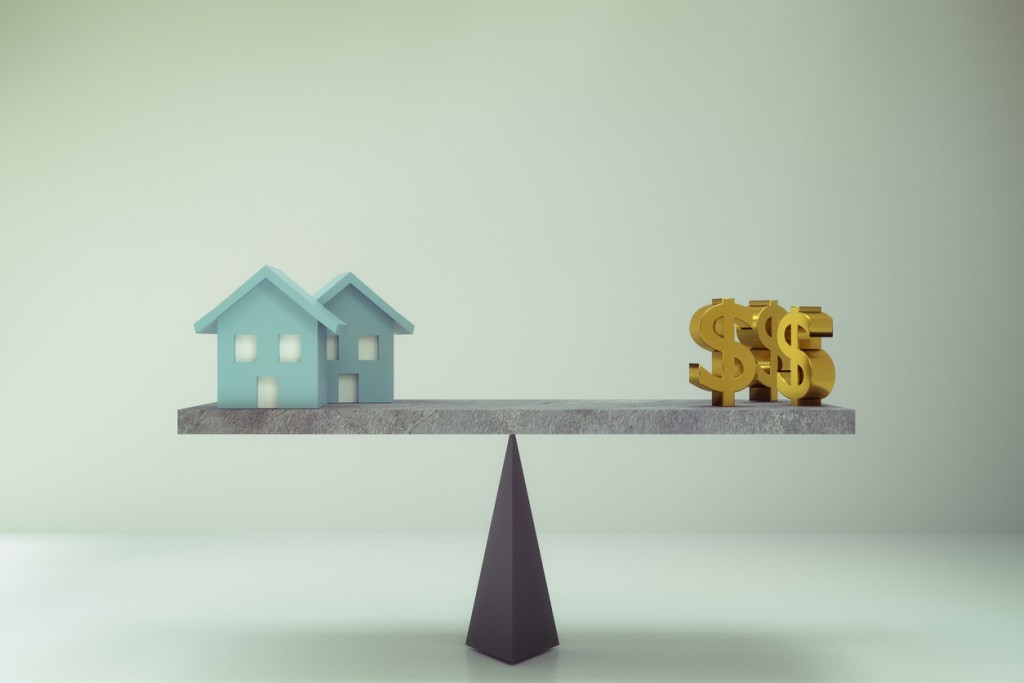 dollar sign and house on balance board
