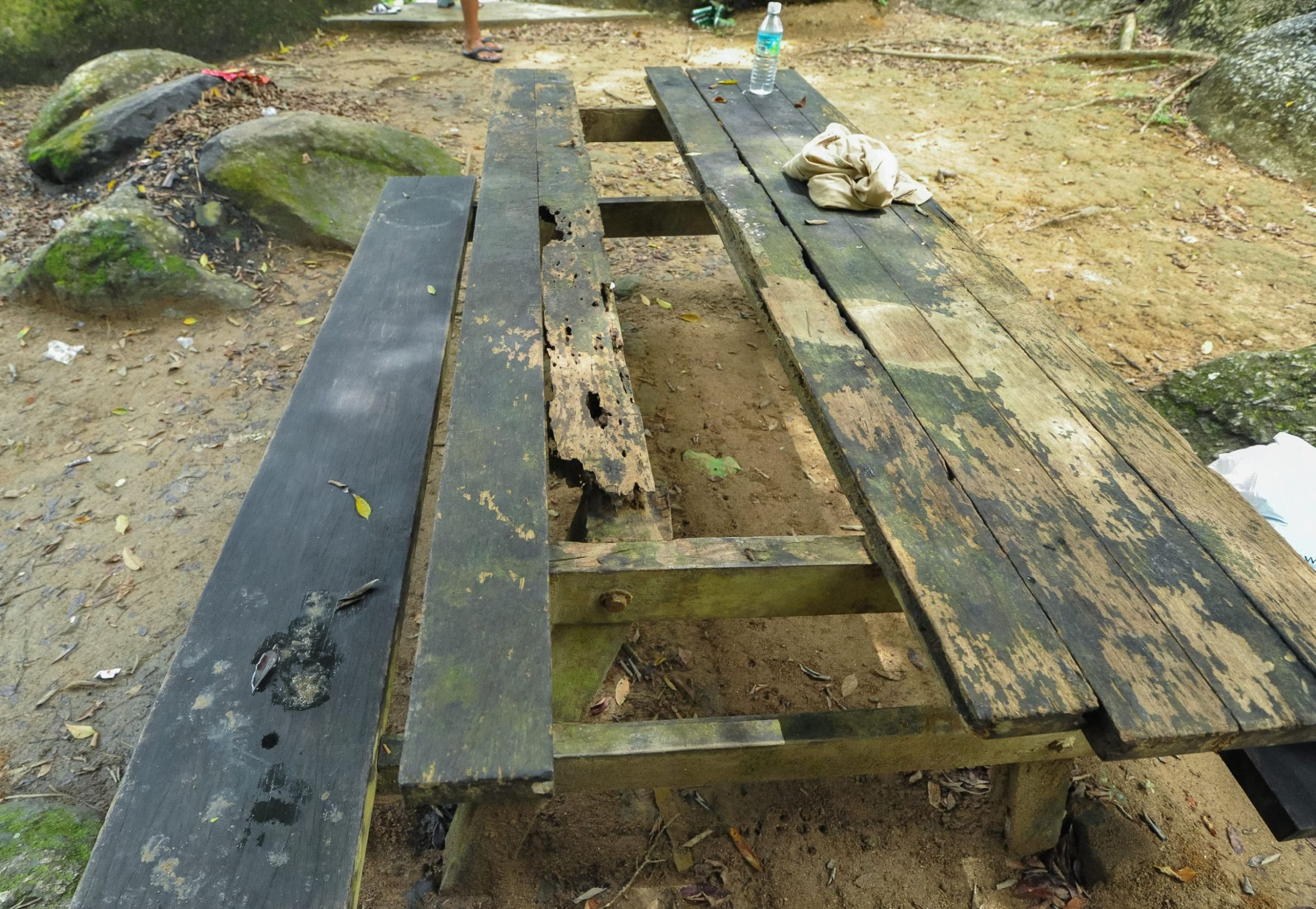 A broken and termite infested picnic table at the Hutan Lipur Lata Kekabu recreational park.