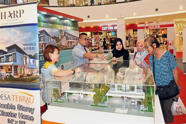 Unbeatable deals: A prospective buyer looking at projects being offered during the StarProperty.my Fair 2018 at Aeon Mall Bandar Dato Onn, Johor Baru.