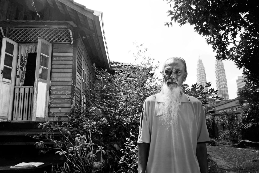 Mr. Zainal, one of Kampung Baru's lifelong residents, has expressed concerns about the village's future. Image credit: Kamal Sellehuddin