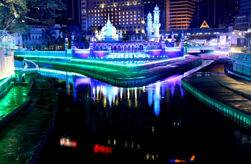 Masjid Jamek , Kuala Lumpur is flanked by the Gombak river (left) and the Klang river, as lit up as part of the River of Life project by DBKL.