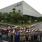 The management team in front of the 18-acres IBS plant