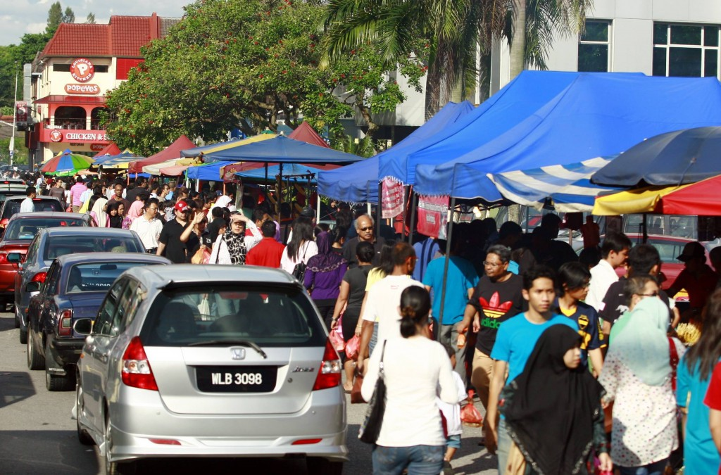 The Taman Tun Dr Ismail (TTDI) Ramadan bazaar started to get packed with people of all races and the roads were jammed with cars at about 5pm.