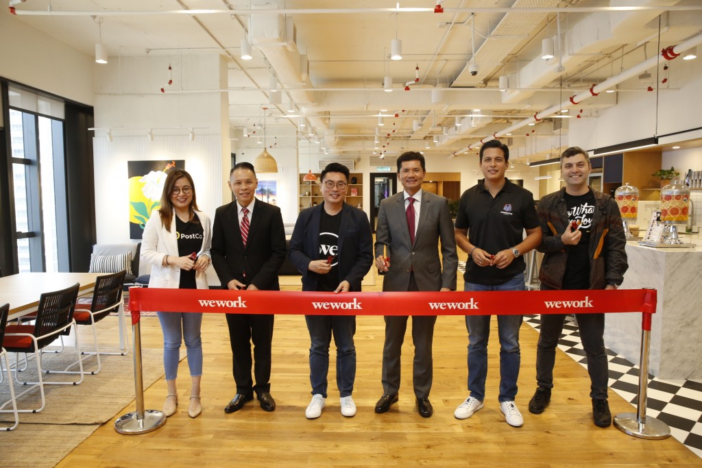 """From left to right: Melisa Wang, Co-Founder and Chief Operating Officer, PostCo; Dennis Tan, Director & Head, Investor Relations - Americas & Europe, InvestKL; Turochas """"T"""" Fuad, Managing Director, WeWork Southeast Asia; Datuk Zainal Amanshah, CEO, InvestKL; Hans-Peter Ressel, Founder and CEO, Momentum Commerce and Eyad Zahra, Head of Community and Member Experience, WeWork Southeast Asia celebrating the official opening of WeWork Equatorial Plaza."""