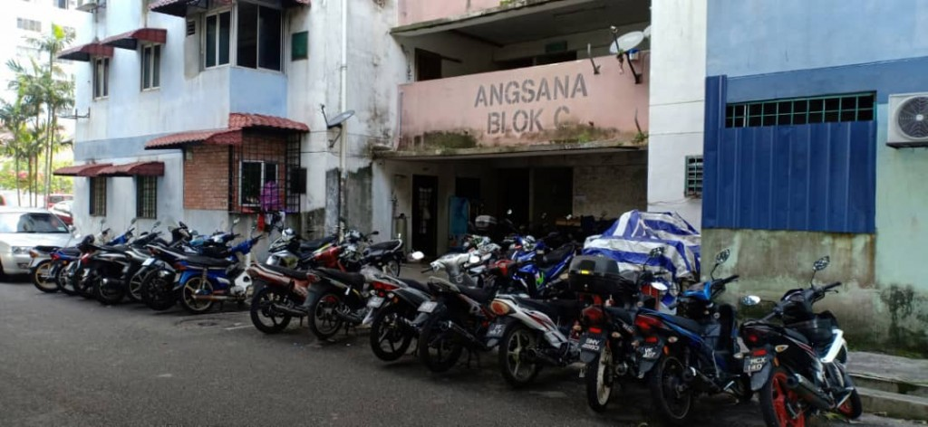Motorcycles parked in front of the entrance will block firemen's access during a fire.