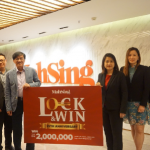 """Senior management team of Mah Sing comprising (from left) branding and strategic marketing general manager Bernard Yong, sales and marketing general manager Chris Chen, CEO Datuk Ho Hon Sang, chief operating officer Everlyn Khaw, sales and marketing general manager Angela Chong and chief operating officer Yeoh Chee Beng unveiling the poster for the """"Lock and Win"""" campaign."""