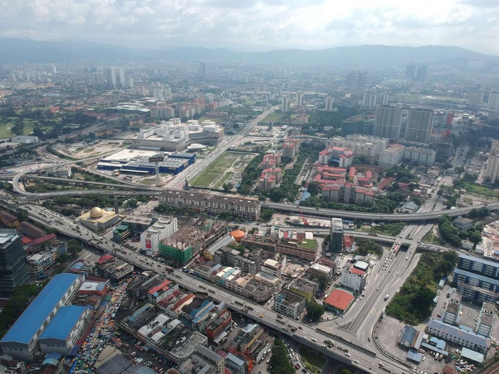 An aerial view of one of Cheras' busiest areas, the convergence between Jalan Yew,  Jalan Pudu,  Jalan Cheras, Jalan Tun Razak, Jalan Cochrane, and the Maju Expressway (MEX), at the blurry border between Kuala Lumpur and Cheras.