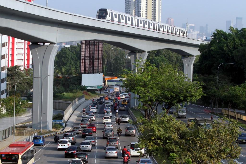 The SBK line MRT coasting over typical rush-hour traffic along Jalan Cheras.