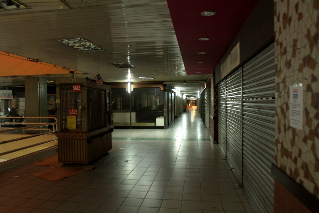 The  quiet and empty Ampang Park shopping centre after tenants moved out and before the complex was demolished.