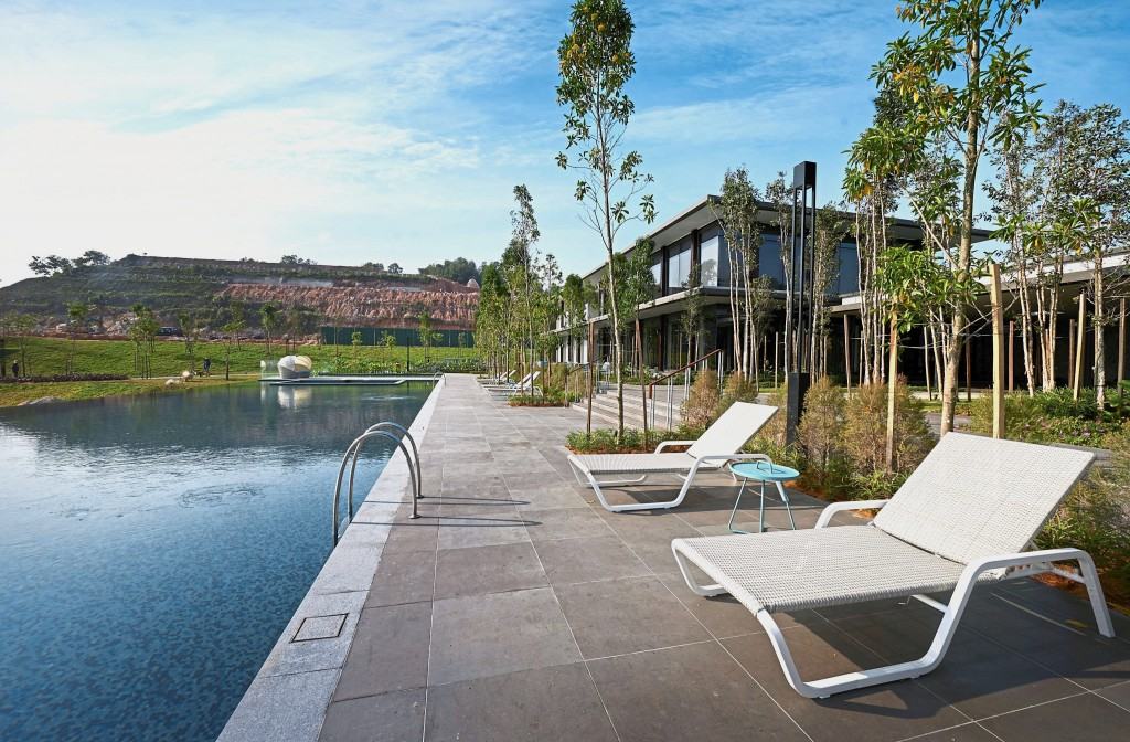 Residents can relax at the Clubhouse while overlooking the olympic length infinity swimming pool.