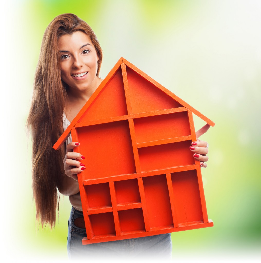 portrait of a pretty woman holding a house design