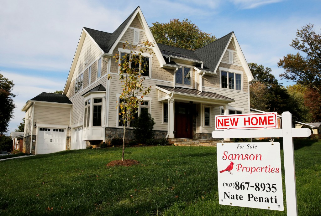 FILE PHOTO: A real estate sign advertising a new home for sale is pictured in Vienna Virginia