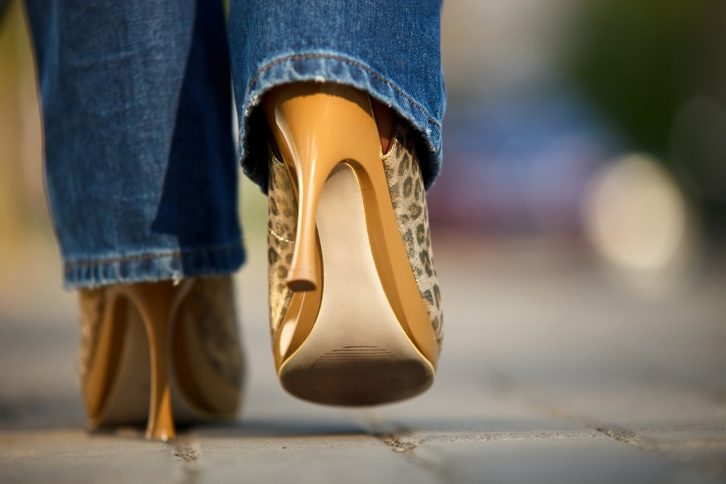 Generic: Close-up view of female in jaguar spotted shoes walking outdoors , stiletto, stilettos, walk, run, girl, city, street fashion