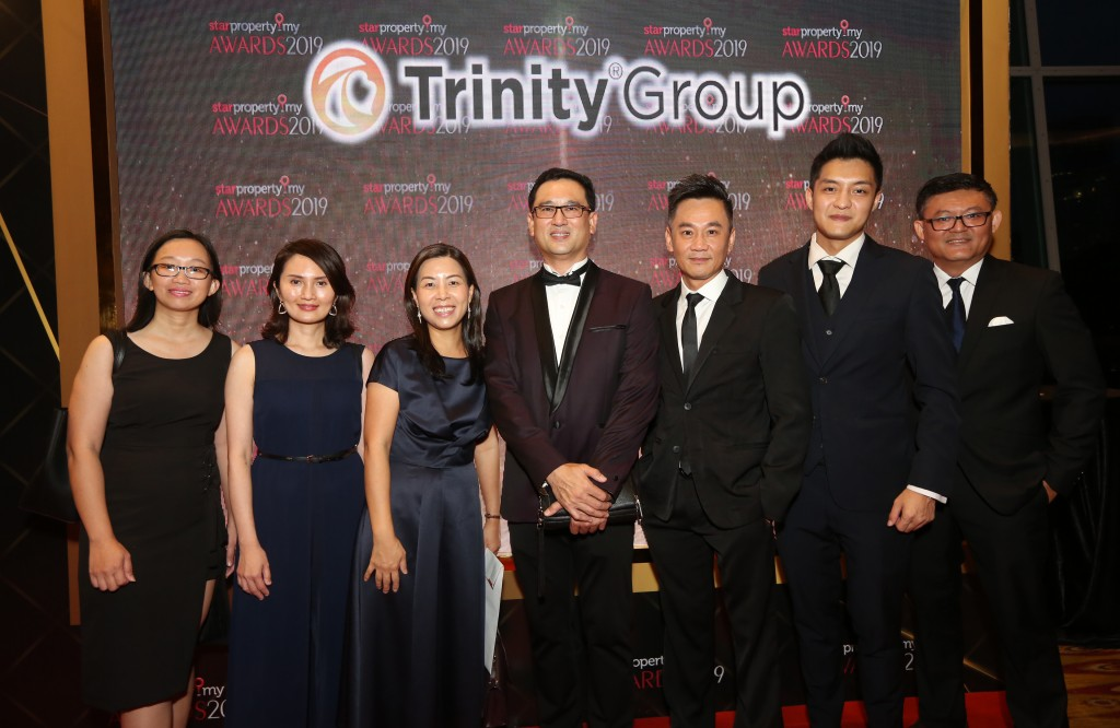 All smiles from Trinity Group Sdn Bhd managing director Datuk Neoh Soo Keat (centre) and his team at the awards night.