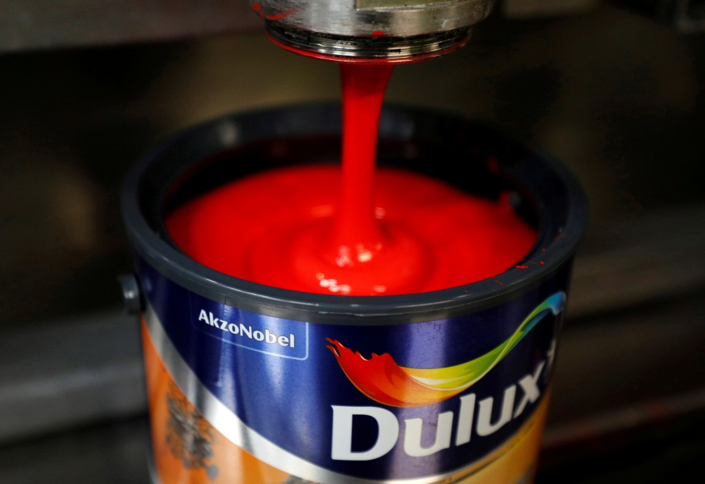FILE PHOTO - Dulux paint cans are filled on the production line inside AkzoNobel's new paint factory in Ashington, Britain  September 12, 2017. REUTERS/Phil Noble/File Photo   GLOBAL BUSINESS WEEK AHEAD