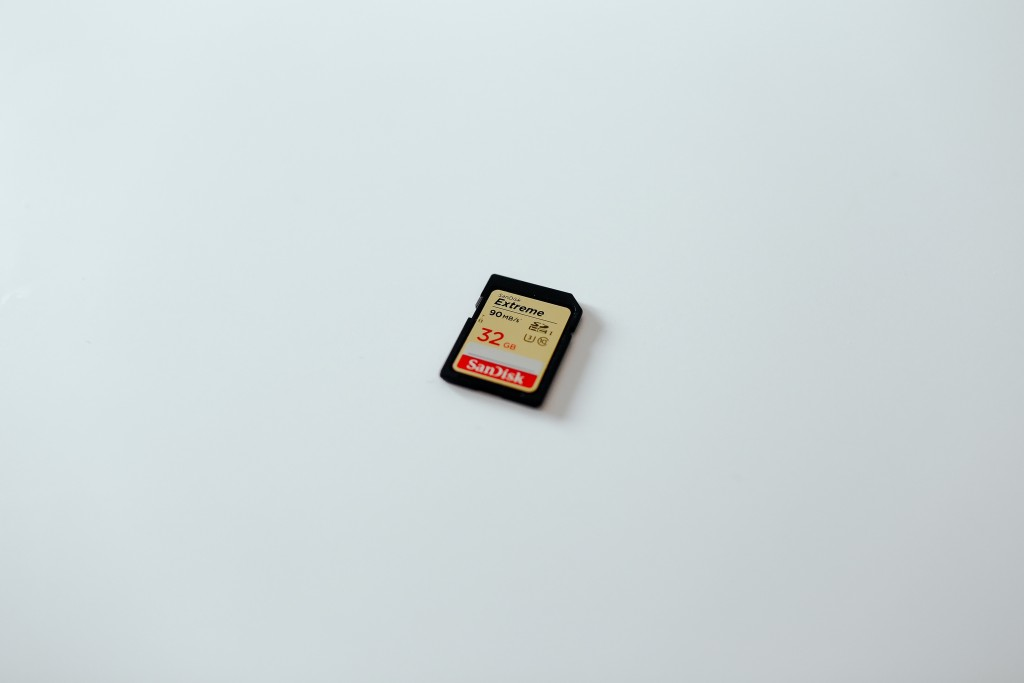 The SD memory card is a recoverable, low-profile form of storage that allows for transmission to be avoided entirely – if it can be reliably recovered. Photo by Tom Pumford on Unsplash.