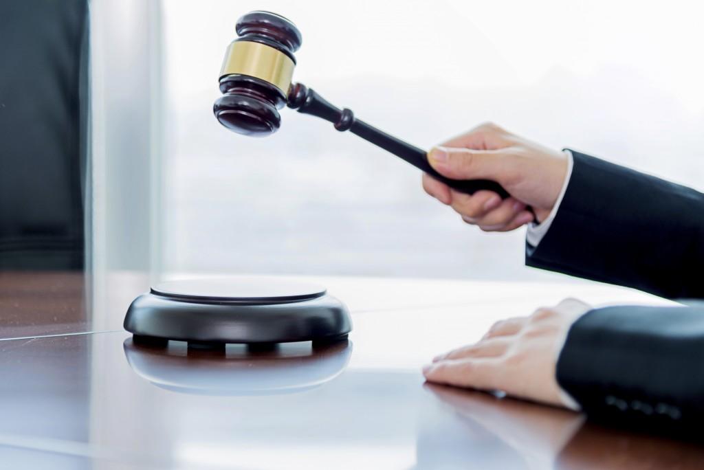 Generic: Female judge - Stock image Auction, Gavel, Legal System, Hammer, Human Hand