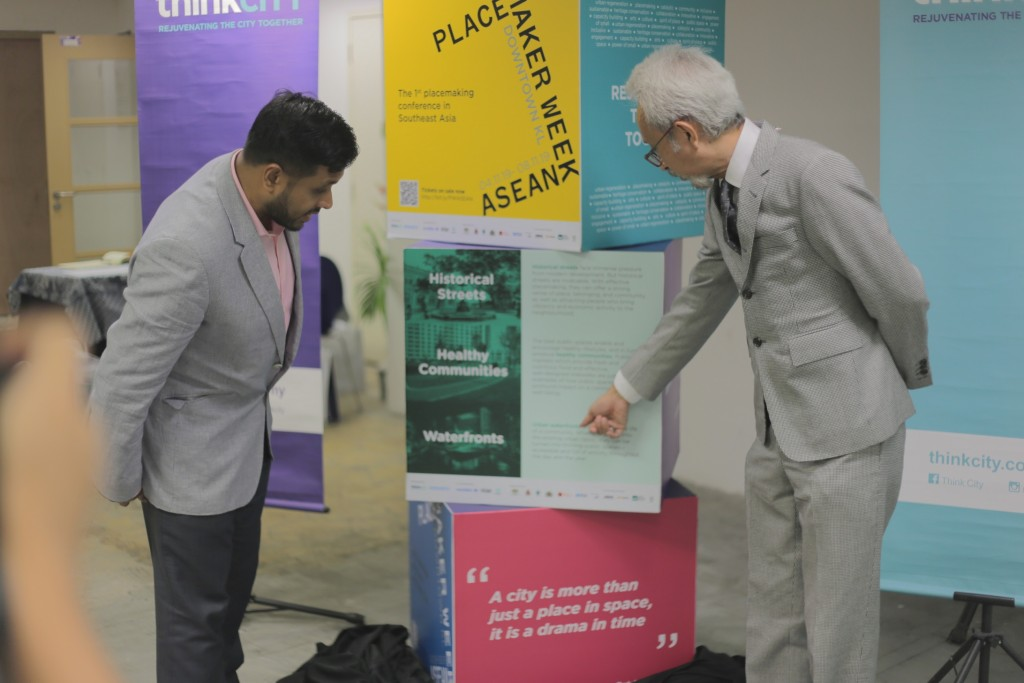 Hamdan Abdul Majeed (left) managing director of Think City Sdn Bhd explaining about Placemaker Week ASEAN 2019 to YBM Senator Dato' Raja Kamarul Bahrin (right), Deputy Minister of Housing and Local Government after the unveiling and official launch the Placemaker Week ASEAN today.