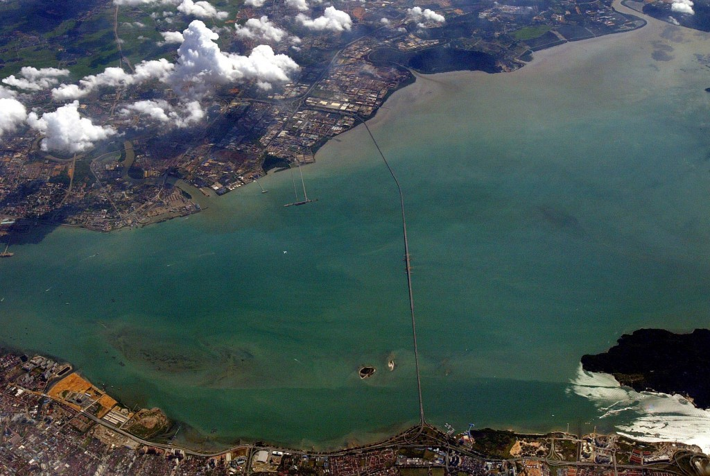 The view of Penang island and Butterworth as seen from a plane. The line connecting both sides is the Penang Bridge.