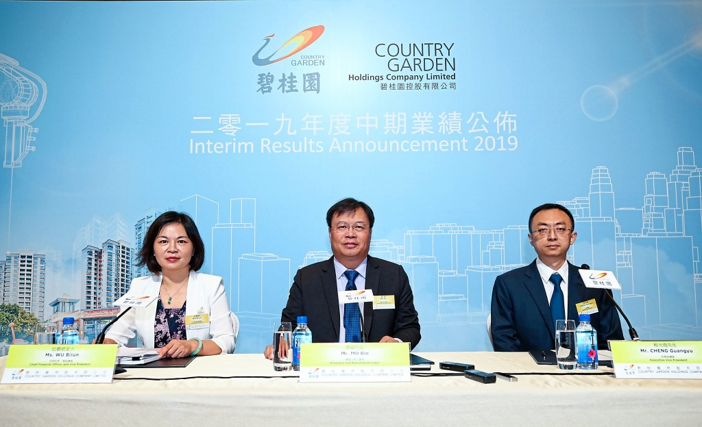 (From left) Country Garden Holdings Company Ltd chief financial officer and vice president Wu Bijun, president and executive director Mo Bin and executive vice president Cheng Guangyu at the announcement of the company's financial results for the first half of 2019 in Hong Kong.