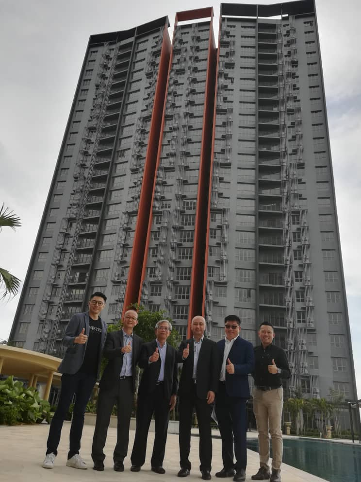 (From left) Chew, Foo, Henry Butcher Real Estate Sdn Bhd chief operating officer Tang Chee Meng, Chuah, Khoo and Mitraland deputy general manager Andrew Tan giving the thumbs up in front of the newly completed Adria tower.