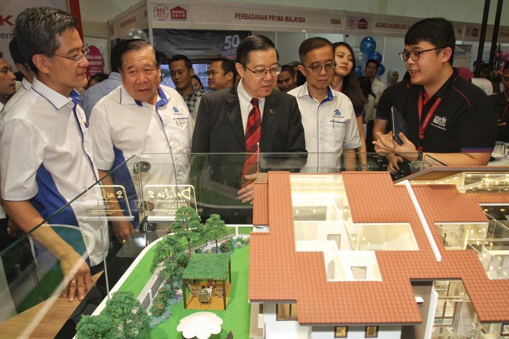 Finance Minister Lim Guan Eng (centre) taking a look at the properties offered at the Mapex event earlier in the year as (from left) Home Ownership Campaign 2019 organising chairman Datuk NK Tong, Mapex organising chairman Dartuk Ng Seng Liong and Rehda president Datuk Soam Heng Choon look on.